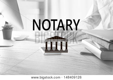 NOTARY. Businessman working on computer indoors