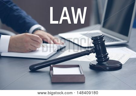 LAW. Judge gavel on table, closeup