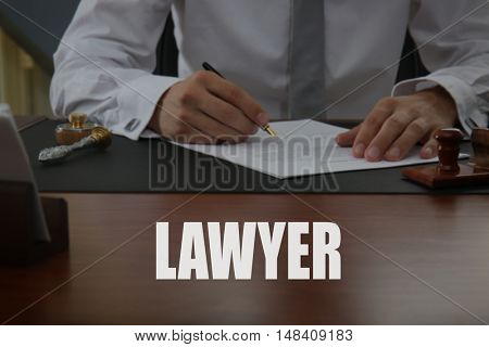 LAWYER. Notary public signing document in office