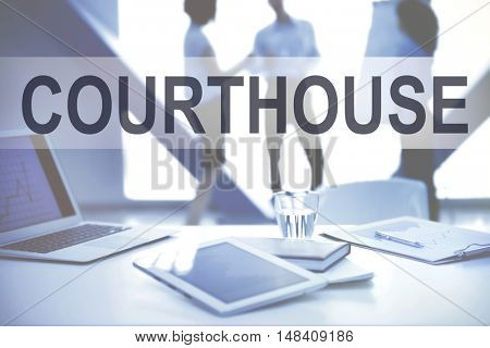 COURTHOUSE. Workplace with tablet on conference background