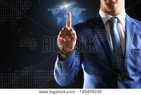 Businessman working with virtual touchscreen. World map and binary code on digital display. Technology concept.