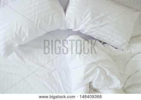 Top View Of Messy Bedding Sheets And Pillows.