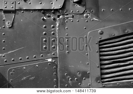 abstract metal sheet with rivets in black and white