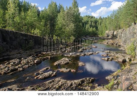 The river and the forest on the beach. Suna River Karelia.