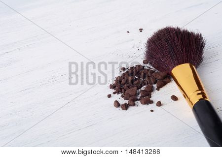 Make up brush with brown powder. Beauty and make up concept.