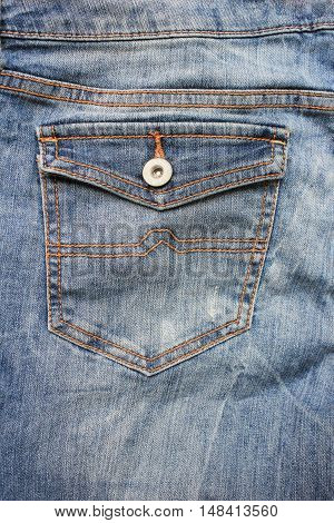 Blue denim jeans back pocket with button texture fabric closeup modern urban lifestyle background with empty copyspace casual style clothing fashion detail