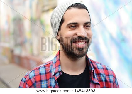 Portrait of young latin man. Urban scene.