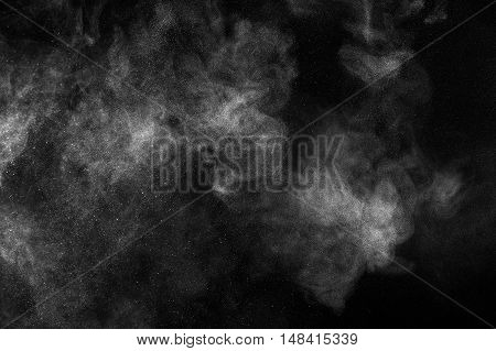 Freeze Motion Of White Particles On Black Background.