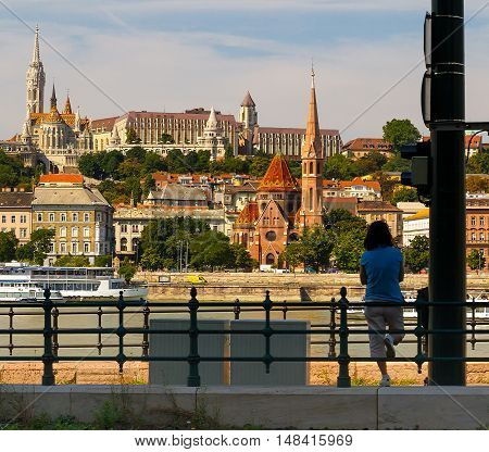 Budapest Hungary - 20 August 2016: A tourist examines the Danube and the Fishermen's Bastion during the celebration of St. Stephen's Day.