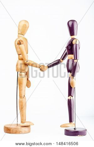 Wooden dummies shaking hands isolated on a white background
