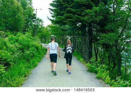 Young couple jogging in park at morning. Health and fitness