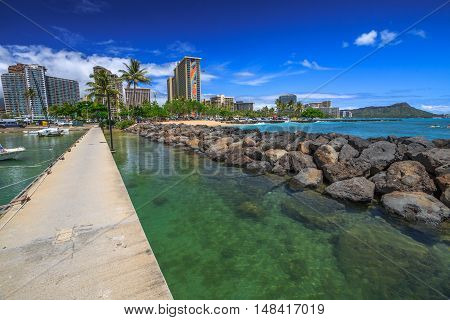 Waikiki, Oahu, Hawaii - August 18, 2016: view of the Hilton Hawaiian Village and the Duke Kahanamoku Beach in Waikiki from Ala Wai Harbor the largest yacht harbor of Hawaii.