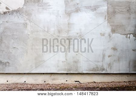 Aged weathered gray plaster street wall background