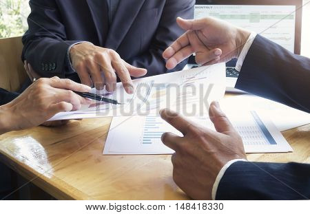 Business people meeting to discuss the situation on the marketing.