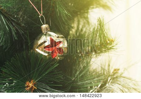 Toy on the Christmas tree - ball with a star
