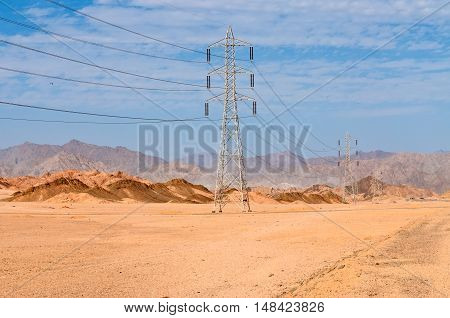 Desert power line and electricity pylons - Egypt