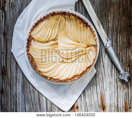 Healthy Pear Tart/ Vegan Dessert on Wood Background