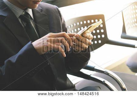 Businessman Using The Smartphone.vintage Tone, Retro Filter Effect, Soft Focus, Low Light.(selective