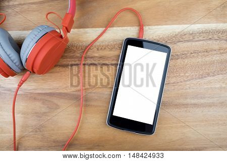Smart Phone Devices With Empty White Screen On Wooden Desk.