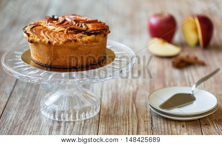 Greek layered apple pie on crystal cake plate