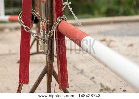 Close-up detail of the locks on a road boom. Infrastructure and security concept.