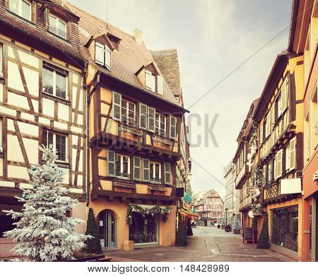 Street decorated for Christmas, Colmar, France. Toned image