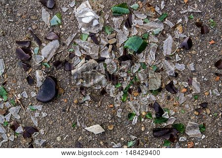 Broken glass, shattered, broken glass pieces, glass debris, cracked glass, broken bottles, asphalt