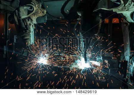 The movement of the three welding robots welding car parts factory.