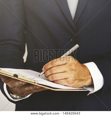 Businessman Writing Clipboard Business Progress Concept