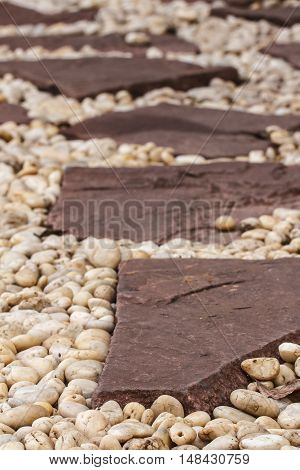 Walkway made ​​of stone in the garden.
