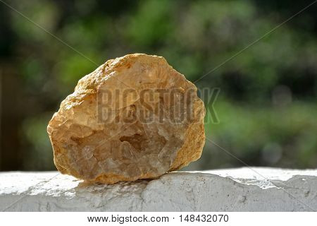 Mineral celestite - Druse white on white wall with green background