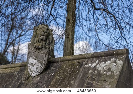 Lion statue, on the walls of Cardiff castle, in Wales, UK