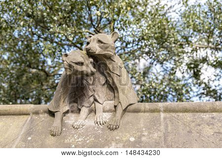 Animal statue, on the walls of Cardiff castle, in Wales, UK