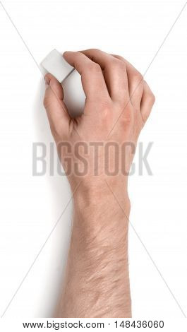 Close up view of a man's hand holding an eraser isolated on white background. Erasing and rubbing off. Drafting equipment. Art and inspiration.