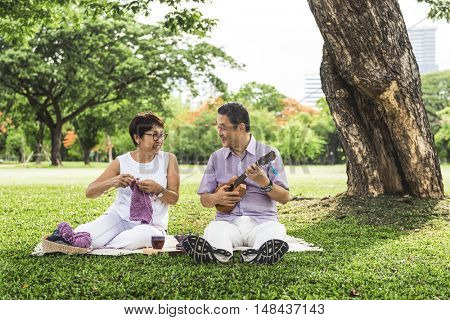 Senior Adult Couple Knitting Park Relaxation Concept