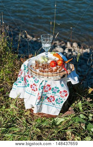 Russian vodka in small glass with snacks at outdoors