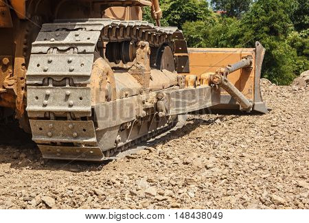The bulldozer working in mining industry, outdoor