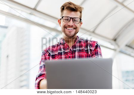 Young Man Smartphone Browsing Laptop Concept