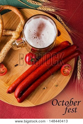 Glass Of Light Beer, Meat Sausages And Tomatoes On Wooden Board