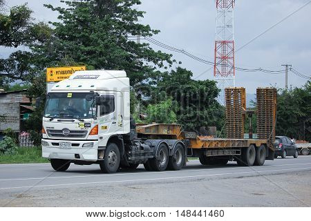 CHIANGMAI THAILAND -AUGUST 18 2016: Trailer truck for move backhoe of PCN Asphalt Company. On road no.1001 8 km from Chiangmai city.