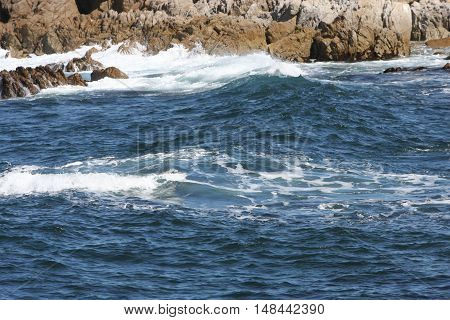 This is an image of the incoming tide at Asilomar Beach in Pacific Grove, California.