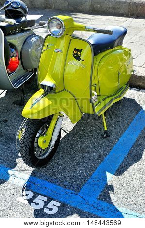 Genova, Liguria, Italy - September 18, 2016: Oktoberfest in Victory Square in Genoa, the first edition of motorsport meeting HBier rally dedicated to Vespas, Lambrettas and Fiat 500. Lambretta X 150 Special, Apple green lammy