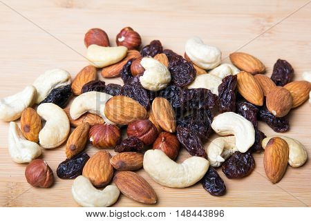 Closeup of a trail mix on wooden background