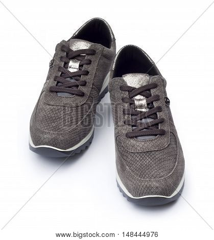 Gray female suede sneakers isolated on white background with clipping path