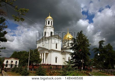 beautiful landscape with russian orthodox church in classical style with white walls and golden roof and dome and belfry in Simferopol