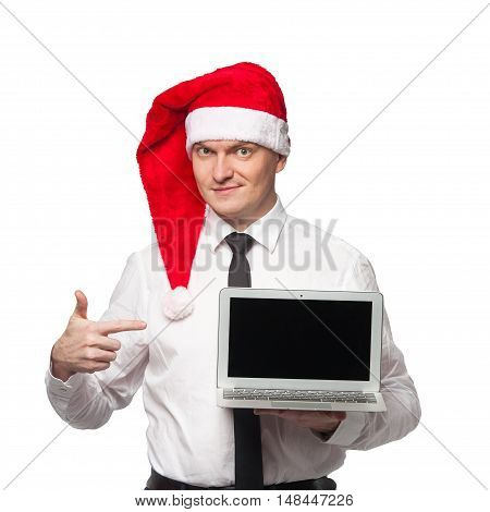 Men In White Shirt Black Tie And Red Santa Claus Heat Smiling And Showing Laptop In One Hand And Sho