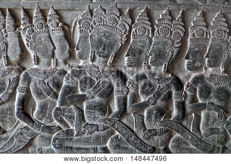 Ancient bas-relief at the facade of Angkor Wat in Angkor, Cambodia. Angkor Wat was built between 1113 and 1150 by King Suryavarman II.