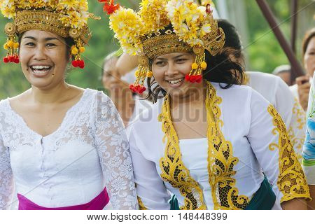 BALI INDONESIA - MARCH 30: Balinese villagers participating in traditional religious Hindu procession before Ogoh-ogoh parade and Nyepi day (Balinese New Year) in Canggu Bali on March 30 2014
