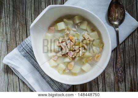 Rhode Island Clam Chowder Soup on Wood Background, top view, close-up.