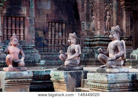 Ancient statue at the Banteay Srey Temple in Angkor Area, Cambodia. Banteay Srey is a 10th century Cambodian temple dedicated to the God Shiva.